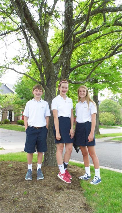 Mary Beth, Maggie, Max, and their favorite honey locust near Christ the King School, April 2015 (K. Leonard)