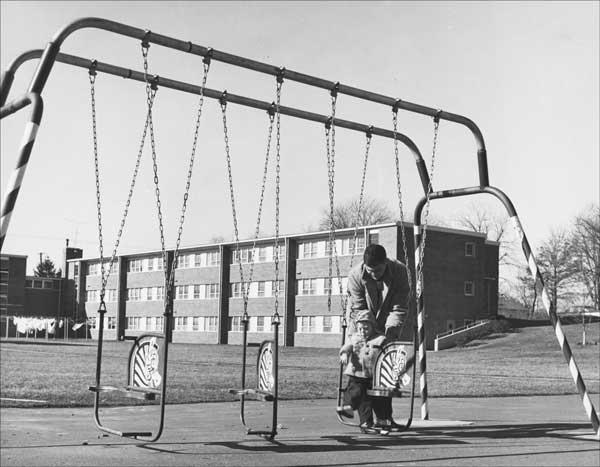 Man and child playing near Cooperstown Apartments, University of Kentucky Archives (1960)